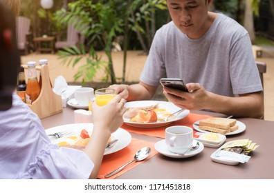 Happy Couple Enjoying Food Thai And Drinks, Having Fun, breakfast at home