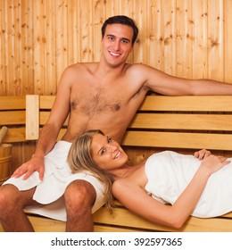 Happy couple enjoying a sauna