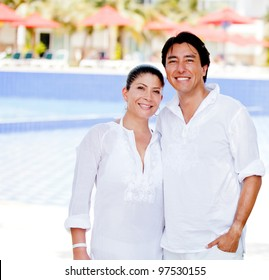 Happy couple enjoying their holidays at a resort