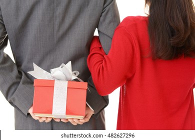 Happy couple with a gift