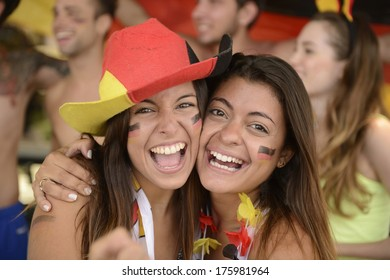 Happy couple of girlfriends sport soccer fans celebrating.