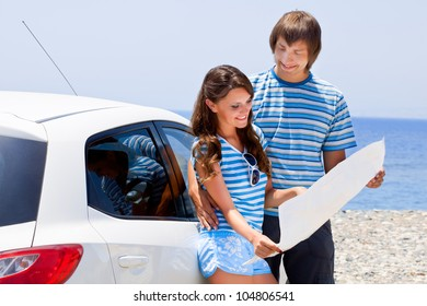 A happy couple is going on a car trip