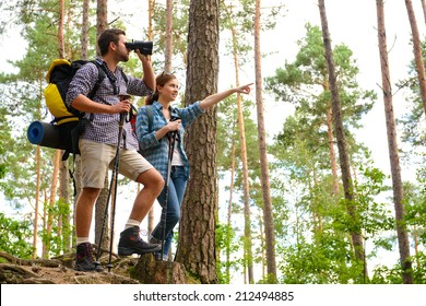 Happy couple going on a hike together in a forest