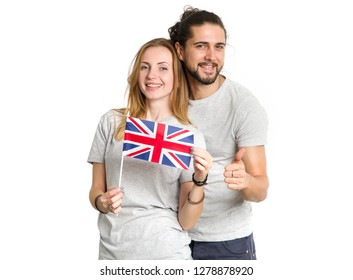 Happy couple in gray t-shirts with the flag of Great Britain, isolated on white background. Young people, man and woman. Learn English.