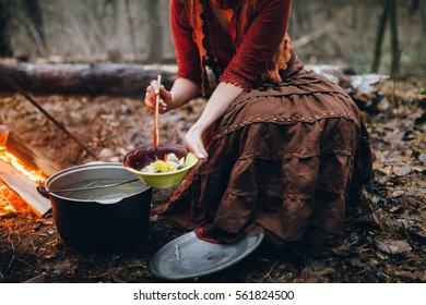 Happy couple having a dinner in the forest