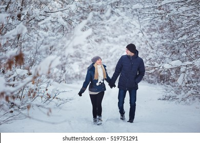 Happy Couple Having Fun Outdoors in Snow Park. Winter Vacation