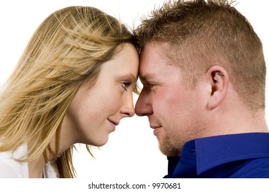 a happy couple is having fun and posing for the camera with their eyes open