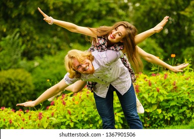 Happy couple having fun together outdoor. Happines, great relationship. Man and woman fooling around.