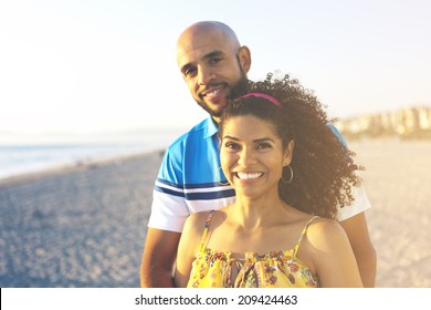 Happy couple having a good time at the beach in the summer sunset.Vintage retro style with soft focus and sun flare .Sunbeams. Enjoyment.