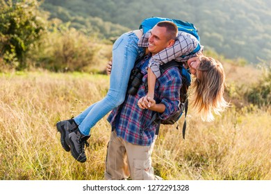 Happy couple is hiking in mountain.