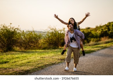 Happy couple is hiking in mountain. They are having fun in nature.