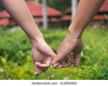Happy couple holding hands.