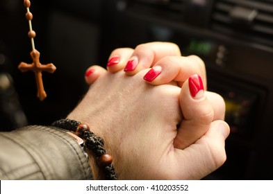 Happy couple holding hands the background of the cross