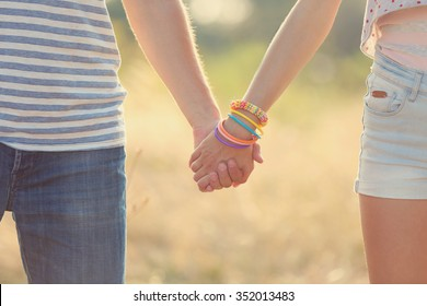 Happy couple holding hands, outdoors