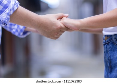 Happy couple holding hands promise or swear symbol.Man woman in love trust and support together.female and male hands together romance concept.married life feeling love romantic.