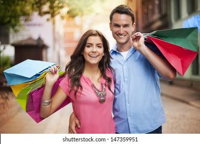Happy couple holding shopping bag