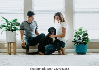 Happy Couple at home with Dog