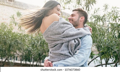 Happy couple in happy hug embracing in outdoors image