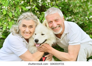 Happy couple hugging dog