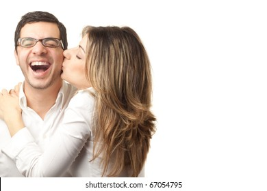 Happy couple hugging and kissing over white background