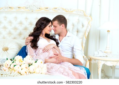 Happy Couple: husband and pregnant wife waiting for baby