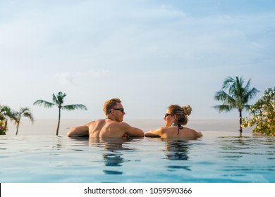 Happy couple in infinity pool