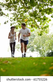 Happy couple jogging at the park - fitness concepts