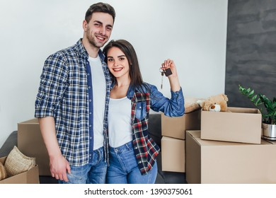 Happy couple with keys from new apartaments!