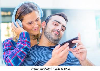 happy couple listening music with headphone