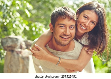 Happy couple looking at camera and smiling