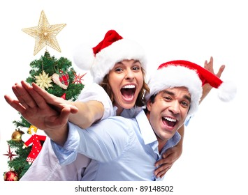 Happy couple in love and Christmas Tree. Isolated on white background.