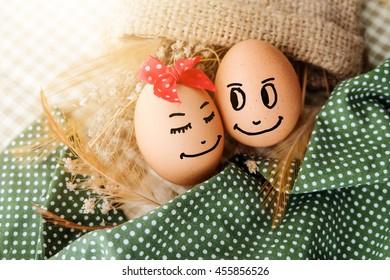 Happy couple in love. Eggs.