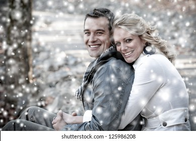 Happy Couple in Love Enjoying the snow
