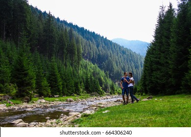 Happy. Couple in love in the forest near river