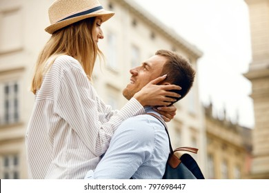 Happy Couple In Love Having Fun On Street. Beautiful Smiling Young Man And Woman Embracing, Laughing And Spending Time Together Outdoors. Romantic Relationships. High Resolution.