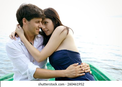 Happy couple in love on boat in vacation