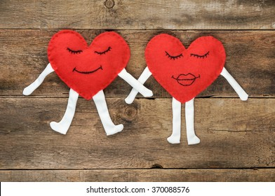 A happy couple in love with  smiles over wooden background