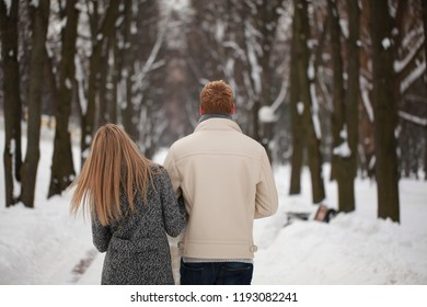 happy couple in love in winter park