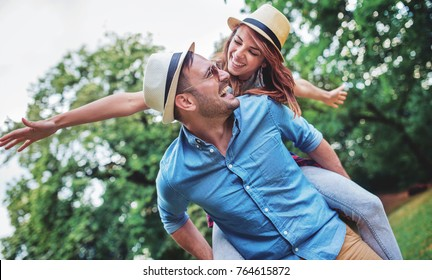 Happy couple. Loving couple enjoying in moments of happiness in the park. Love and tenderness, dating, romance. Lifestyle concept