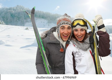Happy couple in the mountains for ski vacation