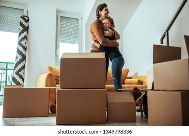 Happy couple is moving into new apartment