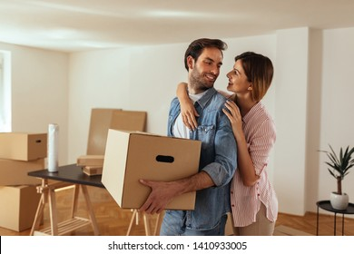 Happy couple moving into new apartment