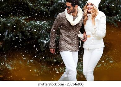Happy couple near a Christmas tree. Christmas Eve.