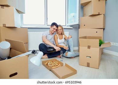 Happy couple in a new apartment for a housewarming.