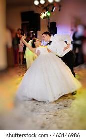 Happy couple of newlyweds dance, groom and bride dancing in restaurant