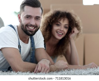 Happy couple on the background of cardboard boxes