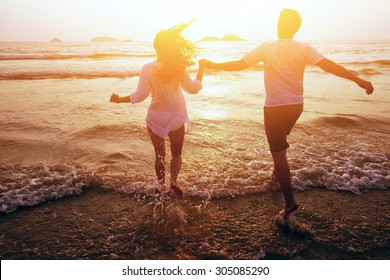 happy couple on the beach, summer vacations or honeymoon