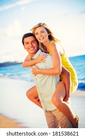 Happy couple on the beach at sunset on vacation