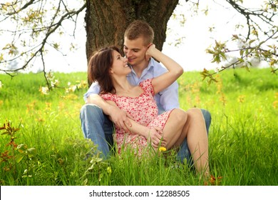 a happy couple on a green meadow