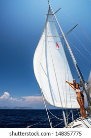 Happy couple on sailboat, young family enjoying sea cruise on sail yacht, active lifestyle, summer adventure, sunny day, vacation concept